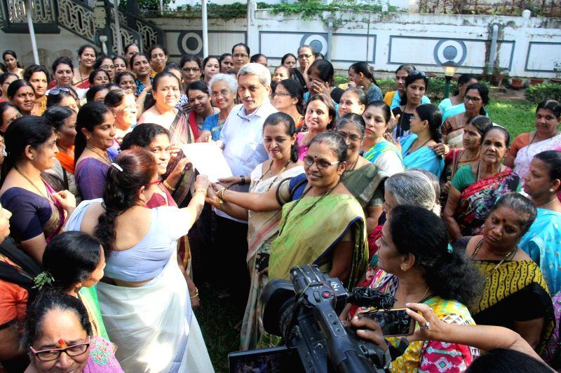 :Panaji: Members of BJP state women's wing meet Goa Chief Minister Manohar Parrikar to demand a ban on the screening of Sanjay Leela Bhansali's film 'Padmavati' at his residence ...
