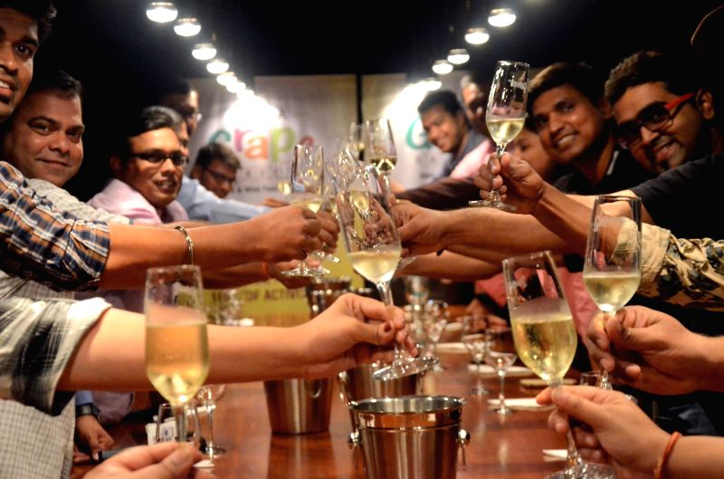 People enjoy wine during wine tasting  at Grover Zampa winery in Sanjegaon Village of Nasik on Feb 10, 2018.