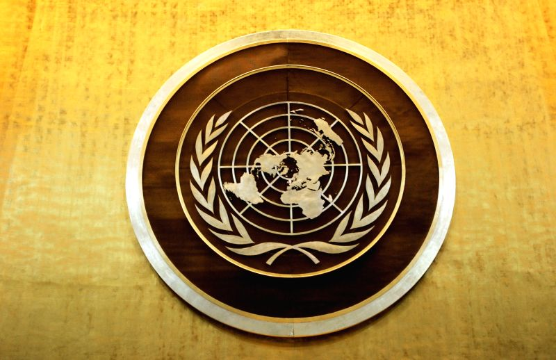 Plaque bearing the United Nations logo above the podium of the General Assembly Hall(Image Source: IANS News)