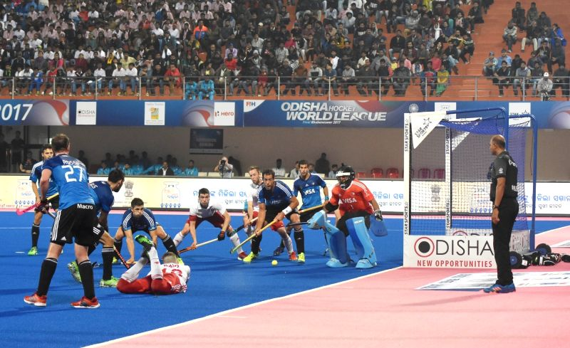 Players in action during a Hockey World League Final match between England and Argentina at Kalinga Stadium in Bhubaneswar on Dec 7, 2017.