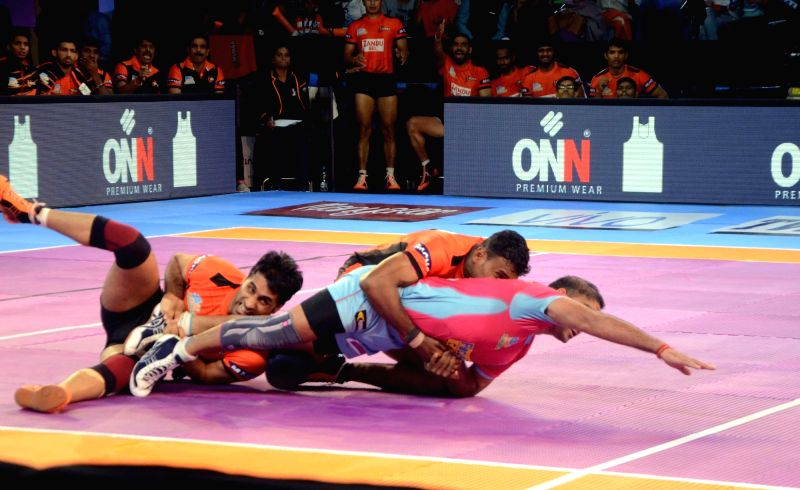 Players in action during a Pro Kabaddi League 2017 match between U Mumba and Jaipur Pink Panthers, in Mumbai on Aug 25, 2017.