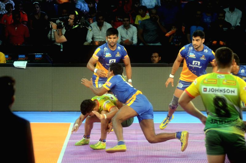 Players in action during a Pro Kabaddi League 2017 match between Patna Pirates and Tamil Thalaivas, in Mumbai on Aug 26, 2017.