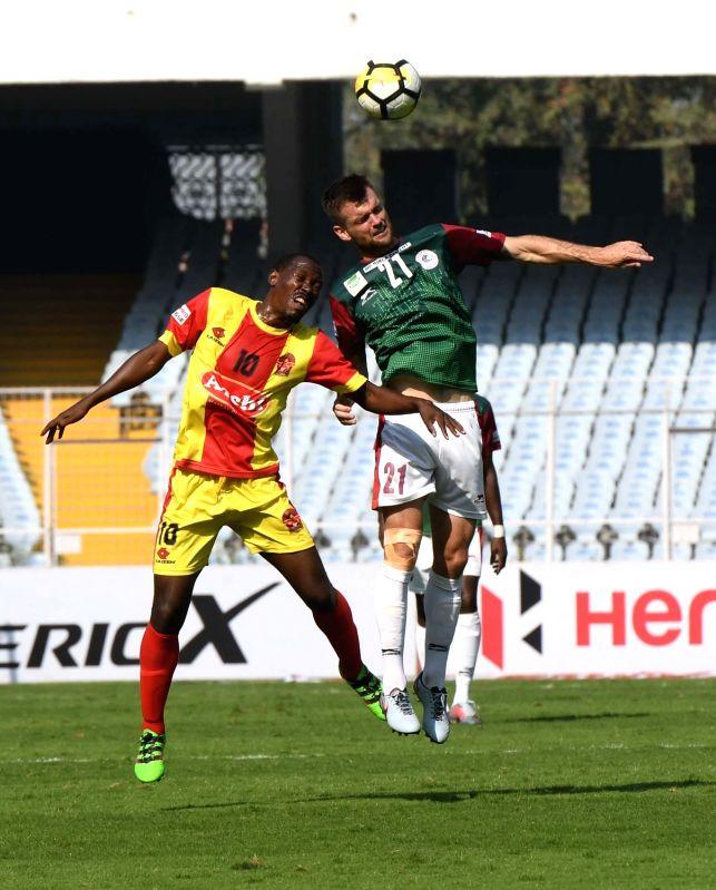 Players in action during an I-League match between Gokulam Kerala FC and Mohun Bagan AC at the Salt Lake Stadium in Kolkata on Feb 12, 2018.