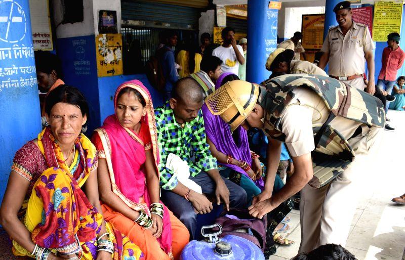 Police personnel conduct security checks amid high alert ahead of the CBI court verdict over in a rape case against Dera Sacha Sauda chief Gurmeet Ram Rahim Singh in Gurugram on Aug 24, ...