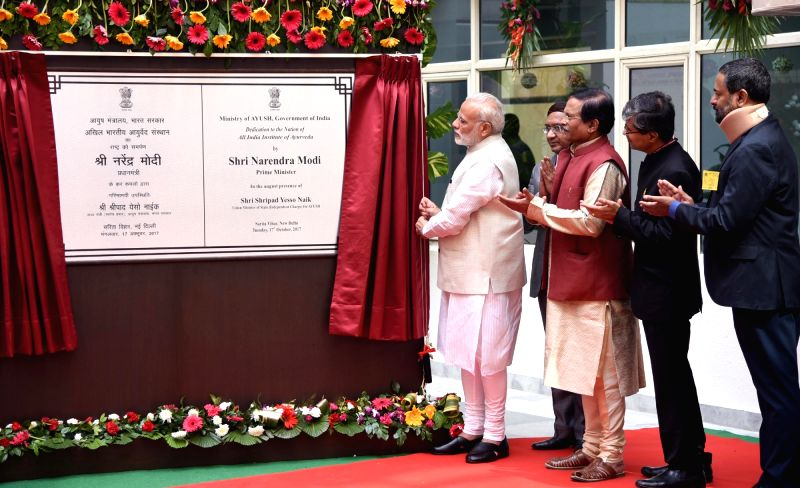 Prime Minister Narendra Modi unveils the plaque to dedicate first ever All India Institute of Ayurveda to the nation on the occasion of 2nd Ayurveda Day, in New Delhi on Oct 17, 2017. Also ...