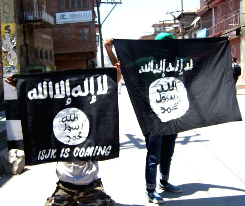 Protesters holding an IS flag during the shutdown called by separatists against the use of tear smoke shells on namazis inside the Jamia Masjid by police in Srinagar on June 27, 2015.