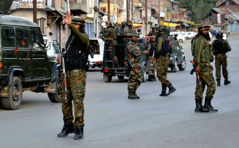 : Qazigund: Security forces in action after militants hurled a grenade at the Central Reserve Police Force (CRPF) patrol at Qazigund in Anantnag district of Jammu and Kashmir on Sept 4, 2017. Five ...