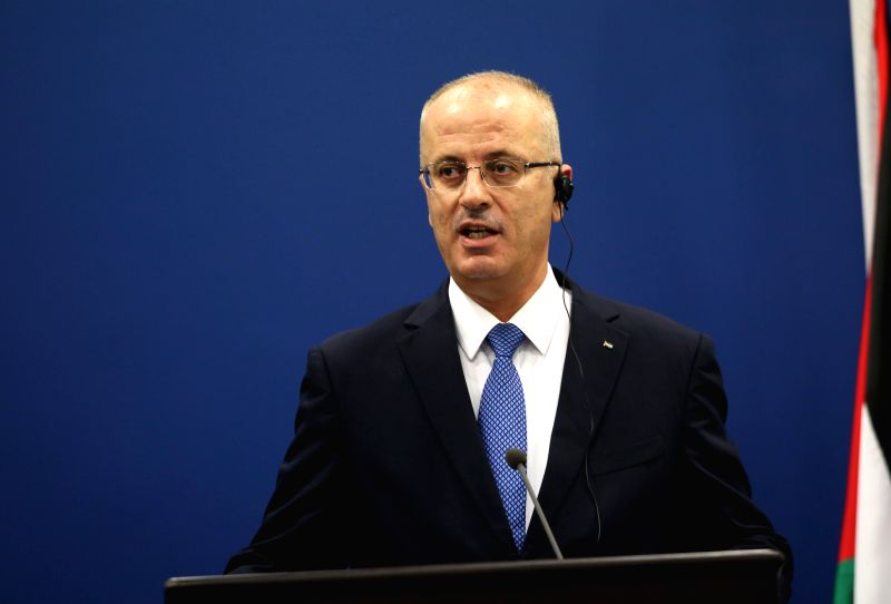 RAMALLAH, May 24, 2016 - Palestinian Prime Minister Rami Hamdallah speaks at a joint press conference with visiting French Prime Minister Manuel Valls (not in photo) in the west Bank city of ...