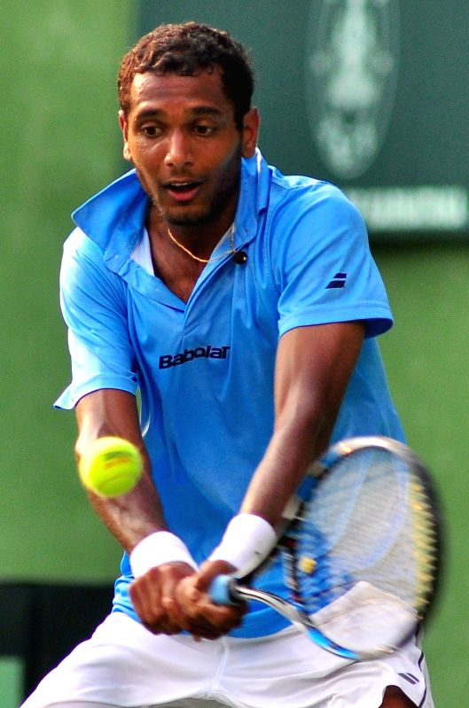Ramkumar Ramanathan of India in action against Temur Ismailov of Uzbekistan during Asia/Oceania Davis Cup at Karnataka State Lawn Tennis Association in Bengaluru, on April 7, 2017.(Image Source: IANS)