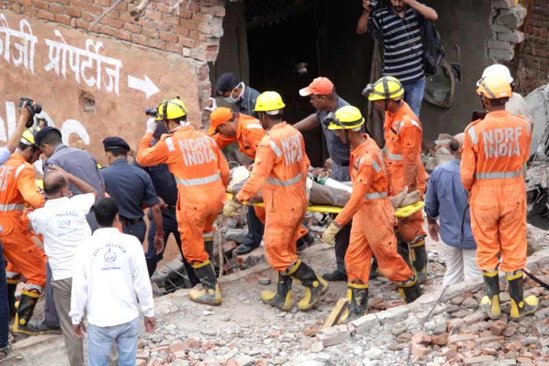 Rescue operations underway at the site where a five-storied building collapsed in Ghaziabad on July 22, 2018.(Photo:IANS)