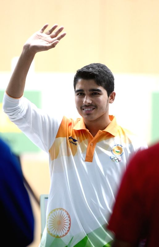 : Saurabh Chaudhary of India greets the audience after the men's 10m Air Pistol final at the 18th Asian Games in Palembang, Indonesia on Aug. 21, 2018. ...(Image Source: IANS)