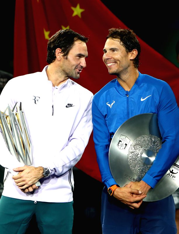 SHANGHAI, Oct. 15, 2017 - Winner Roger Federer (L) of Switzerland talks to runner-up Rafael Nadal of Spain in the victory ceremony of 2017 ATP Shanghai Masters tennis tournament in Shanghai, east ...