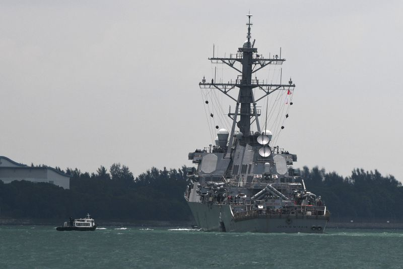 SINGAPORE, Aug. 21, 2017 - U.S. navy destroyer John S. McCain. arrives at the waters off Singapore's Changi Naval Base, Aug. 21, 2017. Ten sailors were missing and five others injured after the ...