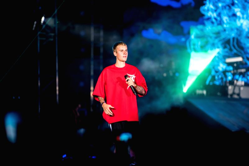 Singer Justin Bieber performs during his concert in Mumbai. (Image Source: IANS)