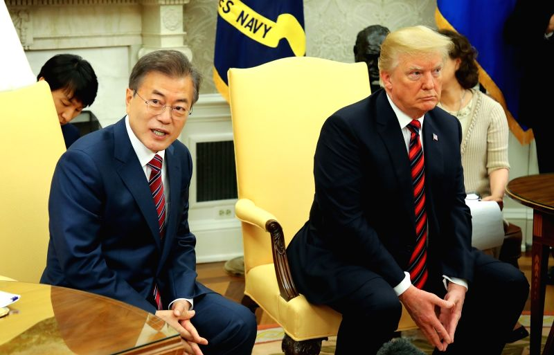 South Korean President Moon Jae-in (L) responds to reporters' questions during his meeting with U.S. President Donald Trump at the White House in Washington on May 22, 2018.(Image Source: Yonhap/IANS)