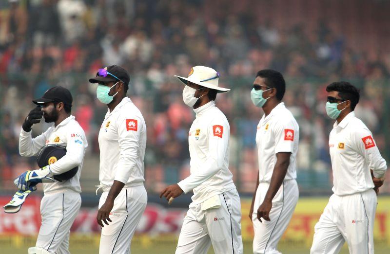 Sri Lankan players wear anti-pollution masks during Day 2 of the third test match between India and Sri Lanka at Feroz Shah Kotla Stadium in New Delhi on Dec 3, 2017.