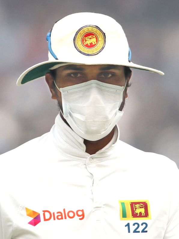 Sri Lankan skipper Dinesh Chandimal fields wearing an anti-pollution mask during Day 2 of the third test match between India and Sri Lanka at Feroz Shah Kotla Stadium in New Delhi on Dec ...