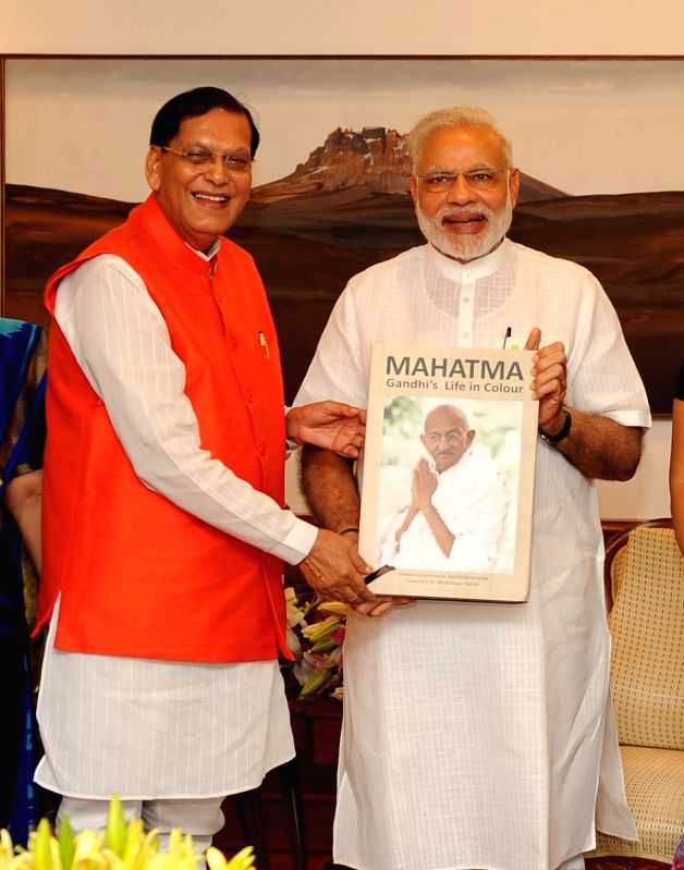 Sulabh International Founder presenting the first copy of book on Mahatma Gandhi?s life to Prime Minister Narendra Modi at his official residence.(Image Source: IANS News)