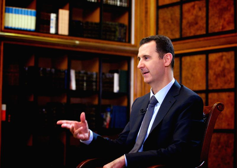 : Syrian President Bashar al-Assad receives an interview with Russia 24 channel in Damascus, capital of Syria, on Spet.12, 2013. Syrian President Bashar al-Assad ...
