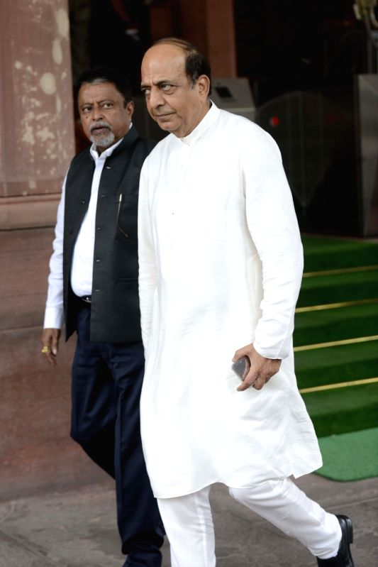 TMC MP Dinesh Trivedi and Mukul Roy at Parliament in New Delhi, on July 25, 2016.(Photo:IANS)