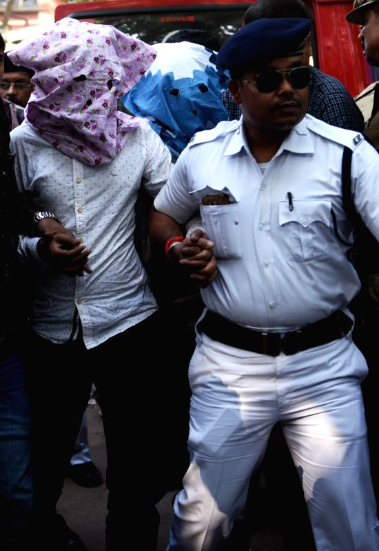 Two teachers of Kolkata's GD Birla Centre For Education who were arrested in connection with the alleged sexual assault of a four-year-old girl student inside a school toilet being taken to ...