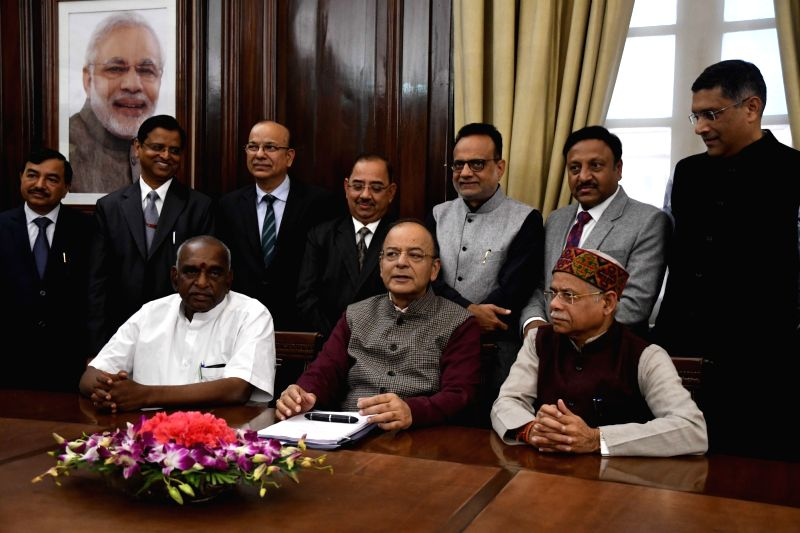 Union Finance Minister Arun Jaitley alongwith his collegues and Ministry official giving final touches to finance Budget papers at the North Block in New Delhi on Jan 31, 2018.(Image Source: IANS)