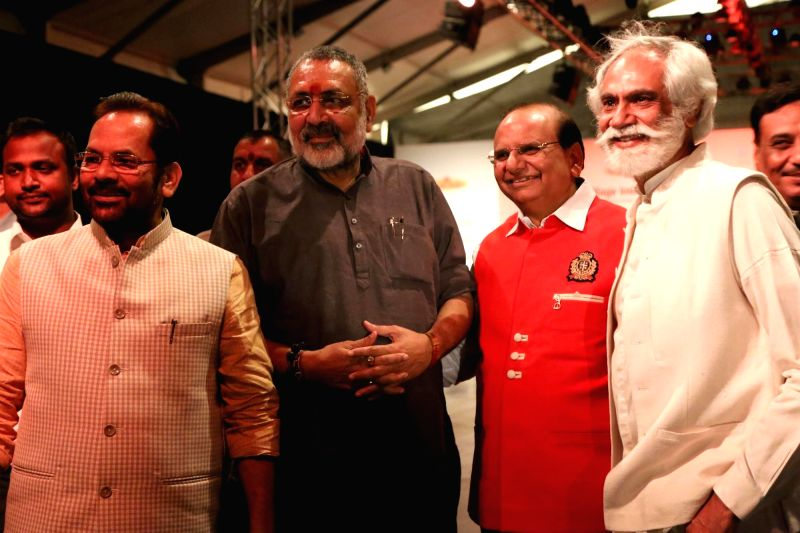 "Union Minister Giriraj Singh and Union Minority Affairs Minister Mukhtar Abbas Naqvi with FDCI President Sunil Sethi at FDCI Fashion Show ""Khadi - Transcending Boundaries"" in ...(Image Source: Amlan Paliwal/IANS)"
