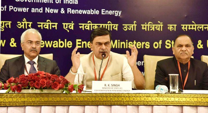 :Union MoS Power Minister Raj Kumar Singh addresses a press conference in New Delhi on Dec 7, 2017. Also seen Ministry of Power Secretary Ajay Kumar Bhalla. (Photo: IANS/PIB).
