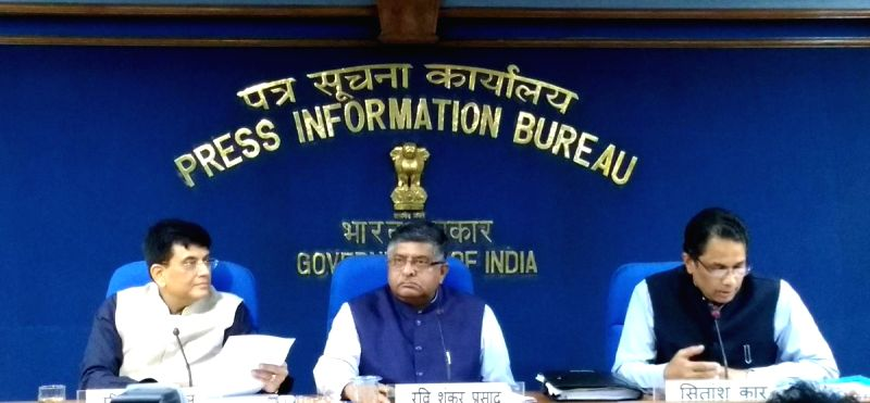 Union Railways Minister Piyush Goyal and Union Law and Justice and Electronics and Information Technology Minister Ravi Shankar Prasad during a press conference, in New Delhi on Aug 1, ...(Image Source: IANS/PIB)