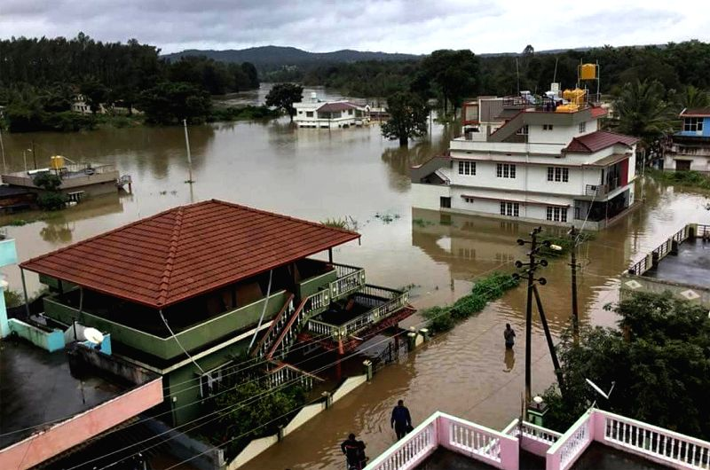 Unprecedented monsoon rains led to flooding of arterial roads and national highways in Srirangapatna on Aug. 17, 2018.(Image Source: IANS)