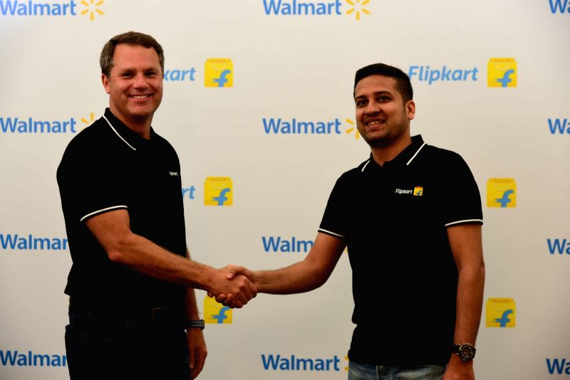 Walmart CEO Doug McMillon and Flipkart Co-Founder and CEO Binny Bansal during an programme to announce Walmart Inc.'s acquisition of Flipkart 77% stake, in Bengaluru on May 9, 2018.(Image Source: IANS)