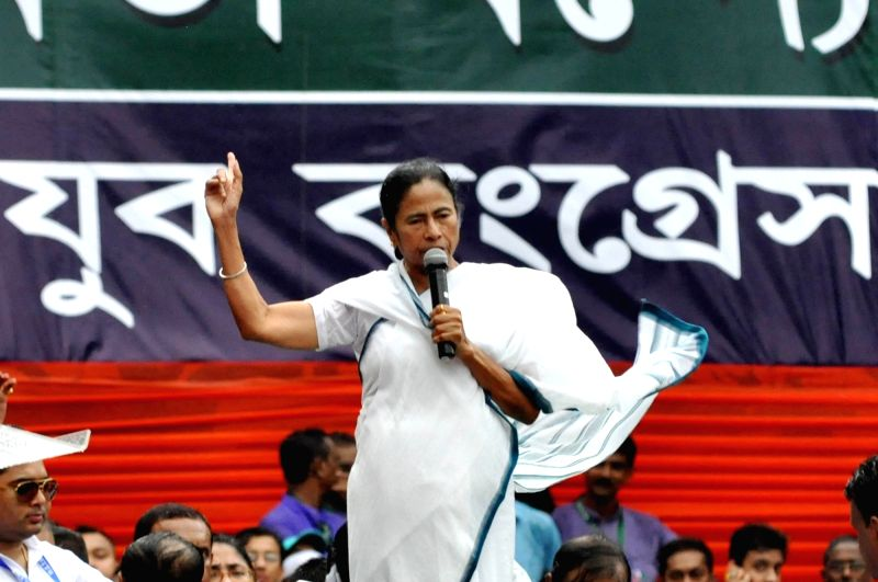 West Bengal Chief Minister and Trinamool Congress (TMC) chief Mamata Banerjee addresses during her party's 25th Martyr's Day rally, in Kolkata on July 21, 2018.(Photo:Kuntal Chakrabarty/IANS)