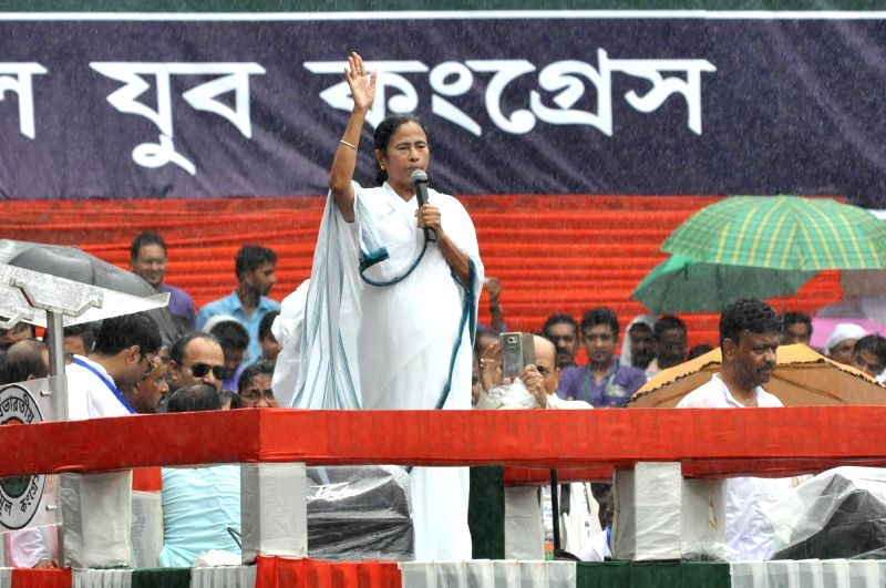 West Bengal Chief Minister and Trinamool Congress (TMC) chief Mamata Banerjee addresses during her party's 25th Martyr's Day rally, in Kolkata on July 21, 2018.(Image Source: Kuntal Chakrabarty/IANS)