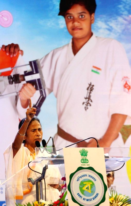 "West Bengal Chief Minister Mamata Banerjee addresses during the 5th anniversary celebrations of ""Kanyashree Diwas"", in Kolkata on Aug 14, 2018.(Image Source: IANS)"