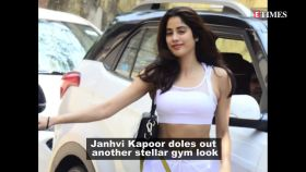 Janhvi Kapoor shows off her toned body in a black crop top and yoga shorts with mesh panel